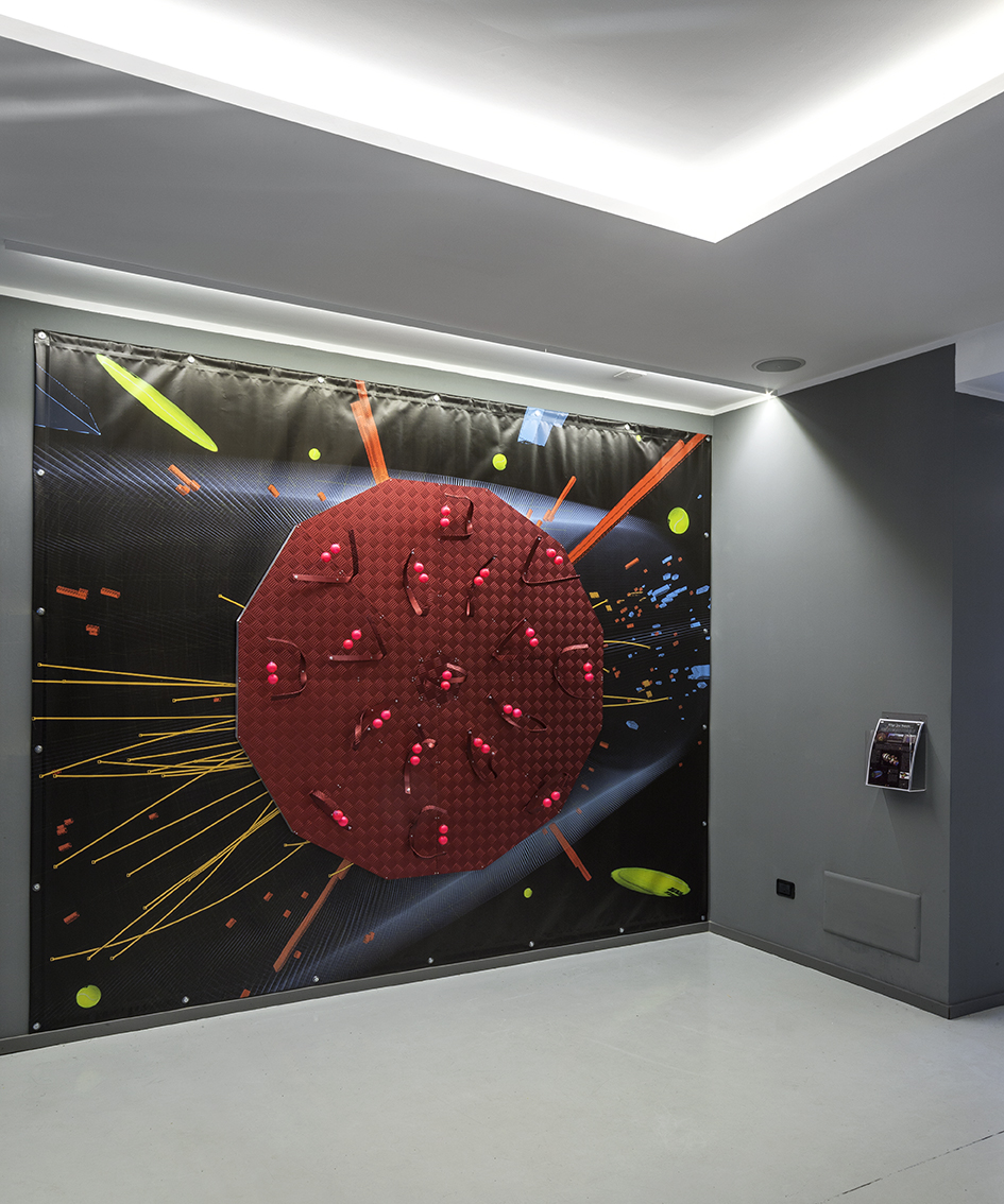 "DETECTORS, 2015 Exhibition view ""The Messengers of Gravity"" MEF (Museo Ettore Fico, Turin), photo credit Beppe Giardino. Background image credit (CMS Experiment, CERN)"